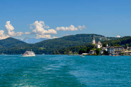 View from the lake on the picturescue village of Maria Worth on Worthersee in Austria