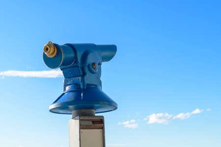 monocular: Blue public coin operated tourist telescope - monocular Stock Photo