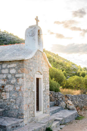 Small stone chappel in the Mediterranean, island of Brac, Croatia  morning daylight
