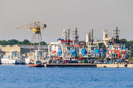 Losinj, Croatia - September 14 2016: Ships on repair. The shipyard Losinjska plovidba was founded in 1850. Its positioned in the northern Adriatic, on the crossing of seaways for repair and reconstruction of ships, which sail in these waters.