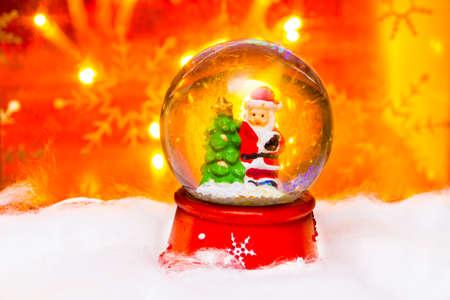 snowdome: Santa in snowdome, Happy New Year 2017, Christmas, bright defocused lights in background