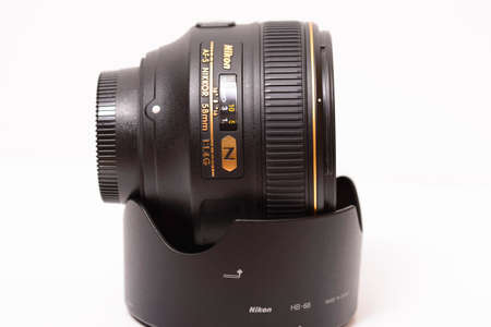 """afs: Ljubljana, Slovenia - September 22 2016: Nikkor AF-S 58mm f1.4G is Nikon's highest-performing """"normal"""" lens with an unusual design goal and particular attention has been given to bokeh and three-dimensional quality that is highly appealing."""