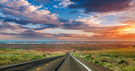 Straight road into the sunset in Arizona