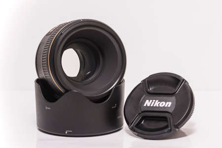 """afs: Ljubljana, Slovenia - September 22 2016: Nikkor AF-S 58mm f1.4G is Nikon's highest-performing """"normal"""" lens with an unusual design goal and particular attention has been given to bokeh and three-dimensional quality that is highly appealing. Editorial"""