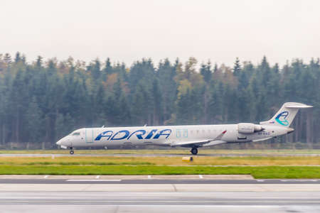 Ljubljana, Slovenia - 19.10.2016: Slovene national airline Adria Airways Canadair Regional Jet CRJ900, S5-AAO taking off at Ljubljana - Brnik Airport.