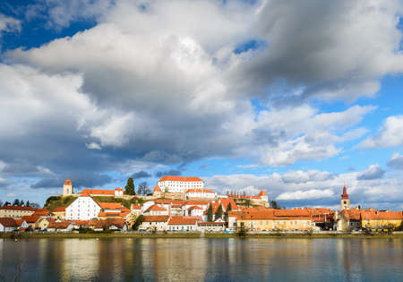 Ptuj, Slovenia, is the oldest city in Slovenia with a castle overlooking the old town from a hill and the Drava river beneath