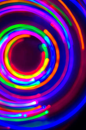 Neon circles, LED Lights Long Exposure, LED Lighting in blue, red, green, pink, cyan and magenta on nlack nackground