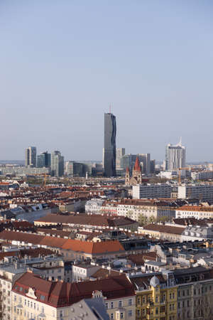 View over Vienna with skyline of Donau - Danube city centre in background, roofs of old town of Vienna in front