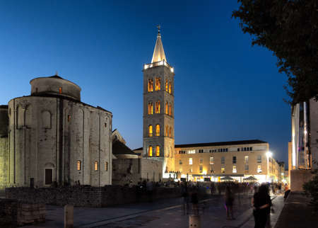 Green Square in Zadar, Croatia at sunset with the ancient church of St Donat and antique Roman square, long exposure, people unrecognizable and faces blurred