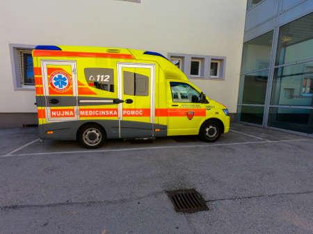 Slovenska Bistrica, Slovenia - October 4 2018: Primary health centre in Slovenska Bistrica is regional emergency rescue centre for 35.000 inhabitants. Modern ER ambulance vehicle in front of clinic.