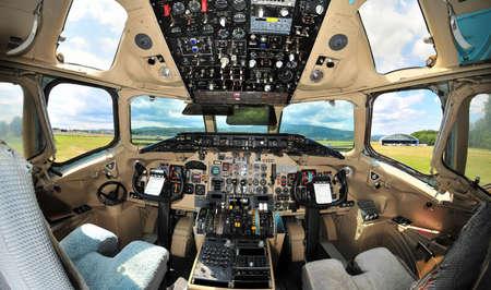 Vintage passenger jet aircraft cockpit interior, pilots instrument panel