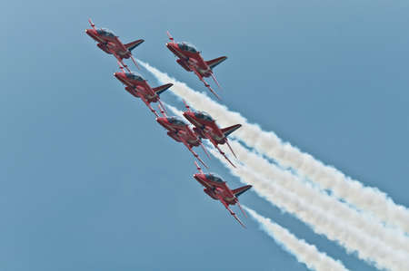 Maribor, Slovenia - June 3 2011: Red Arrows Aerobatic Display Team performing at public airshow in Maribor. The Red Arrows are the official display team of Royal Air Force. Free admittance to show. Redactioneel