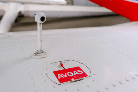 Pitot probe on top of light aircraft wing, close up detail with fuel tank latch Banque d'images - 124691143