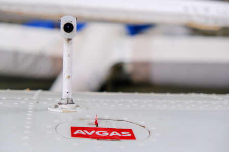 Pitot probe on top of light aircraft wing, close up detail with fuel tank latch Stock Photo - 124691144