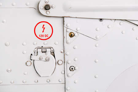 Detail of light sport aircraft fuselage, electric socket on cowling Banque d'images - 124691149