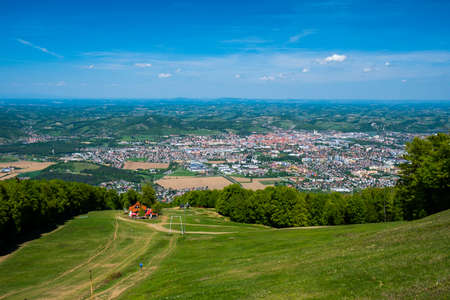 Panoramic view of Maribor, Slovenia from Pohorje, mountain hut luka in front, outdoor spring and summer recreation and hiking on ski slopes of Slovenia Imagens