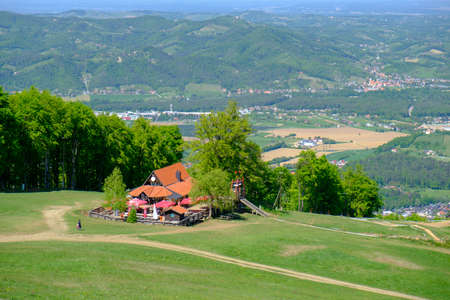 Maribor, Slovenia - 02 May 2019: Mountain hut Luka on the ski slopes of Pohorje with Maribor offers rest and refreshments to hikers and skiers while offering a magnificent view on Maribor, Slovenia