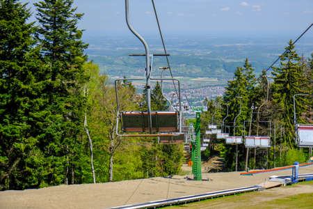Empty ski lift in the summer, preparation for winter skiing season, ski slopes outside winter season