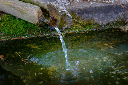 Mountain spring with fresh water, closeup, drinking water, water shortage concept, refreshment for hikers, ecology and natural reserves