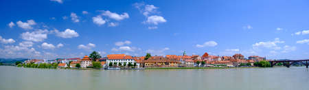 Lent district in Maribor, Slovenia, a popular waterfront promenade with historical buildings on the banks of Drava river, large panorama