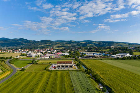 Slovenska Bistrica, Slovenia - June 9 2019: Aerial view of wastewater and sewage treatment plant in the outskirts of Slovenska Bistrica.