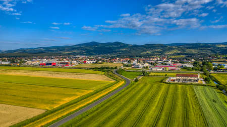 Slovenska Bistrica, Slovenia - June 9 2019: Aerial panoramic view of small town in rural Europen landscape and mountains in background, Slovenska Bistrica, Slovenia Sajtókép