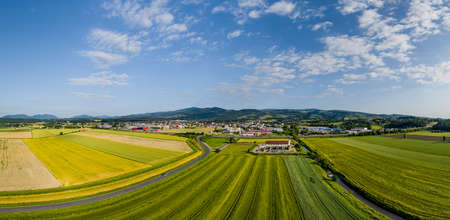 Slovenska Bistrica, Slovenia - June 9 2019: Aerial panoramic view of small town in rural Europen landscape and mountains in background, Slovenska Bistrica, Slovenia Редакционное