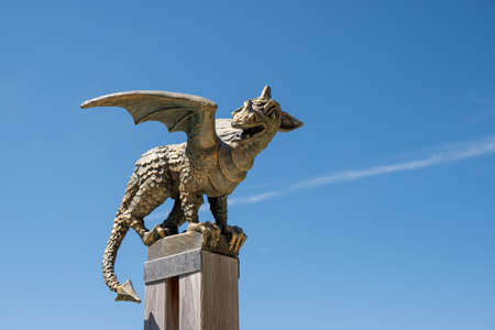 Solcava, August 17 2019: Bronze statue of the Lintver dragon, a signpost on the Solcava Panoramic road above Logar valley in Slovenia Редакционное
