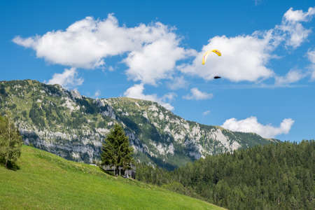 Paraglider flying in the mountains, Alpine landscape in Slovenia