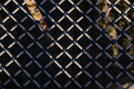 Suspended walkway safety net, mesh pattern, tied rope and knots, detailed close up view, graphical background Stockfoto