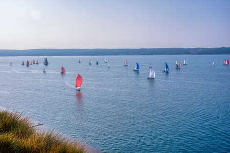 Portoroz, Slovenia - Oct 12 2019: Sailing boats sail from Portoroz towards gulf of Trieste, Italy to participate at Barcolana 2019 regatta