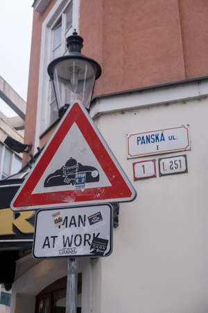 Bratislava, Slovakia - Spet. 25 2019: Man at work signpost in the streets of Bratislava, Slovakia, street worker in the sewers warning sign Sajtókép