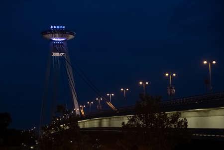UFO Bridge over Danube River in Bratislava, Slovakia, illuminated at night