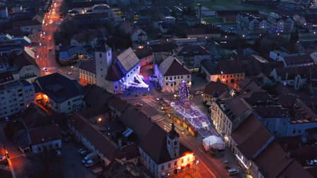 Aerial view of Christmas fair on main square in Slovenska Bistrica, a small medieval town in Slovenia, shops closed on Xmas eve