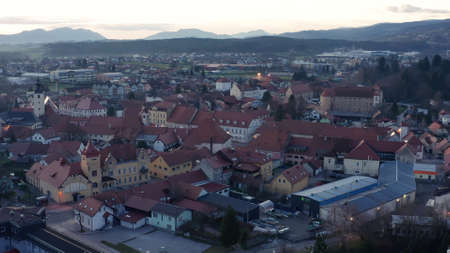 Evening aerial view of small medieval town in Europe with historic buildings, church and a castle, Slovenska Bistrica, Slovenia