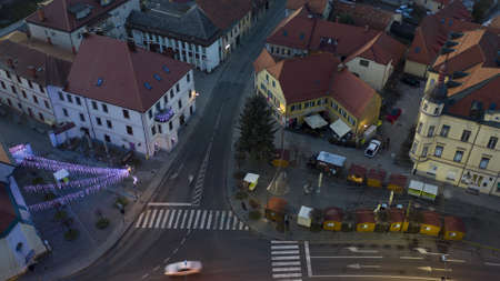 Slovenska Bistrica, Slovenia - Dec 25 2019: Christmas lights switch on in main square of small town Slovenska Bistrica, Slovenia, aerial time-lapse of Xmas market with decoration