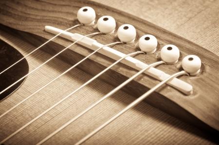an acoustic guitar bridge in grunge retro style