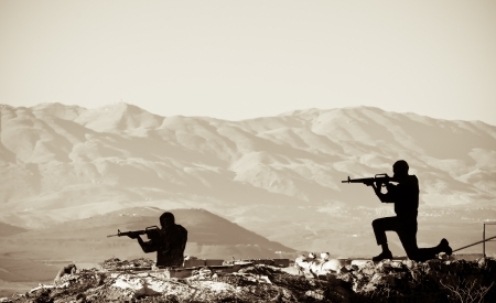 iraq war: A figure of a Shooting Man  with a mountainous backdrop Stock Photo