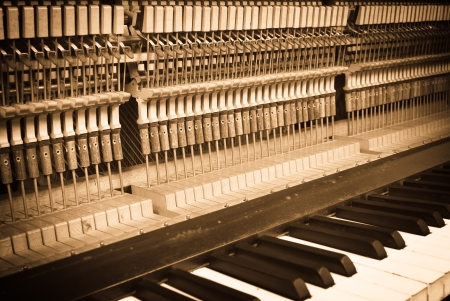 classical mechanics: the interior of an old piano - grunge style