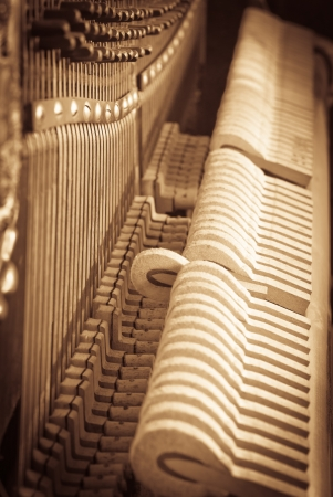 grand design: the interior of an old piano - grunge style