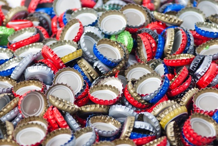 water pollution: Bottle caps background Stock Photo