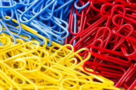 red blue and yellow paper clip background Stock Photo