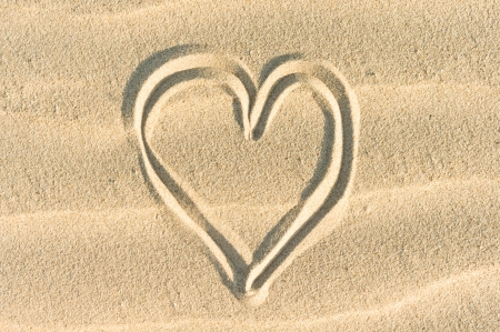 evoke: heart drawn on sand Stock Photo