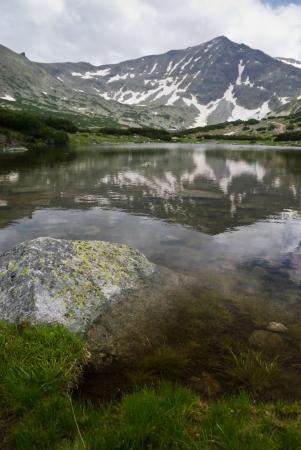 A mountain reflecting in pond - Bulgarian Balkans photo