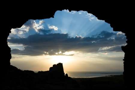 sunset framed in a cave entrance