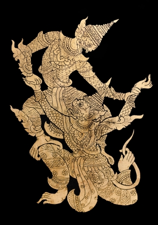 Traditional golden Burmese figures on black background photo