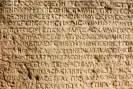 ancient Greek writing chiselled on stone photo