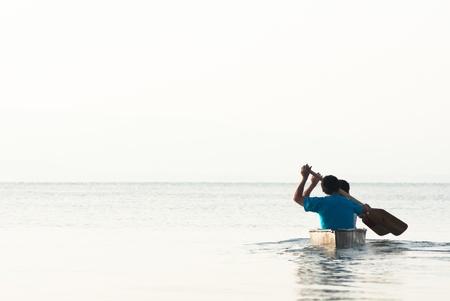 galilee: Two men paddling in a canoe at the sea of Galilee