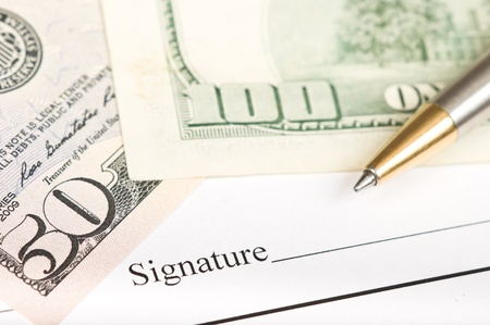 Signing on a legal business form photo