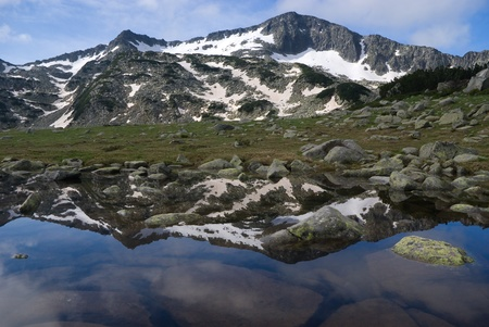 Mountain reflecting in pond in the Pirin range - Bulgarian balkans photo